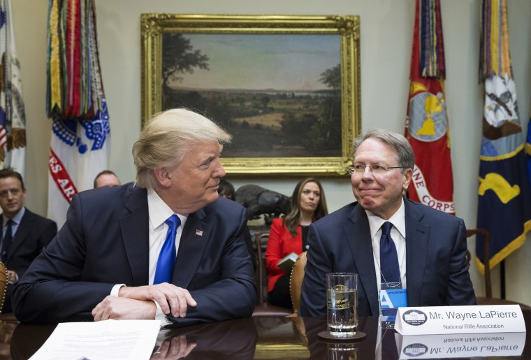 Image: President Donald Trump sits next to National Rifle Association Executive Vice President Wayne LaPierre at the White House