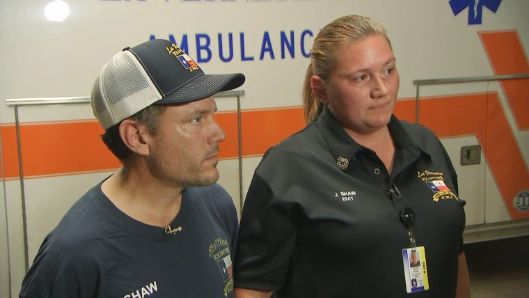 Image: Paramedics Mike and Jamie Shaw of the La Vernia Emergency Medical Service talk to Gabe Gutierrez about being first on the scene of the shooting in Sutherland, Texas.
