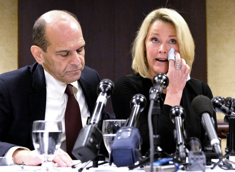 Image: Former Boston news anchor Heather Unruh sits with her attorney Mitchell Garabedian at a press conference in Boston