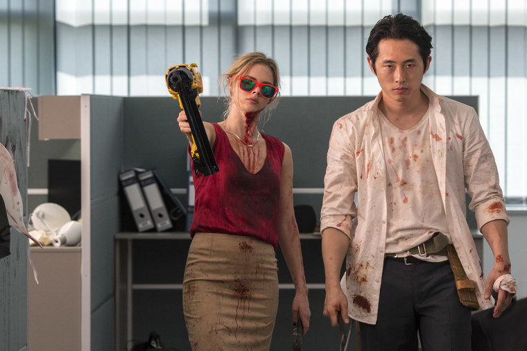 "Samara Weaving as Melanie Cross and Steven Yeun as Derek Cho in the horror-action film ""Mayhem,"" an RLJE Films release"