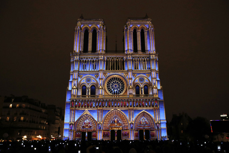 "Image: The Notre Dame cathedral is illuminated during a light show called ""Dame de Coeur"""
