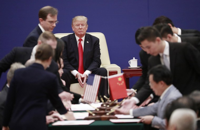 Image: President Trump looks on during a signing ceremony at the U.S.-China Business Exchange at the Great Hall of the People in Beijing, China, Nov. 9, 2017.