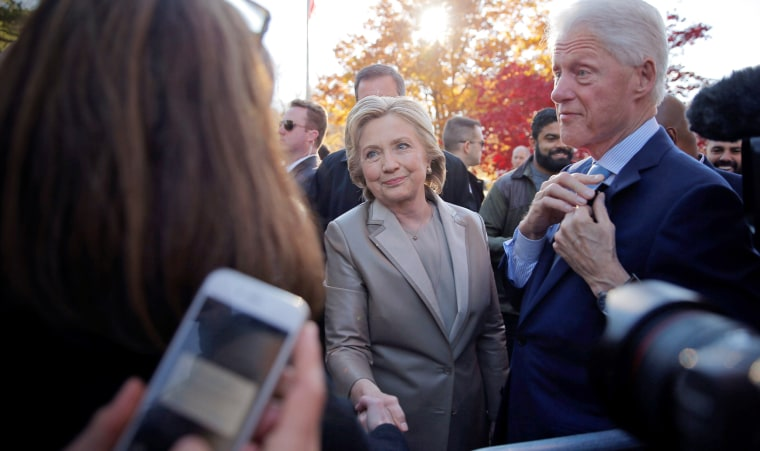 Image: Then-Democratic presidential nominee Hillary Clinton and her husband former President Bill Clinton meet with supporters
