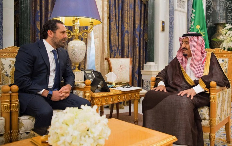 Image: Saudi King Salman, right, meets with outgoing Lebanese Prime Minister Saad Hariri in Riyadh