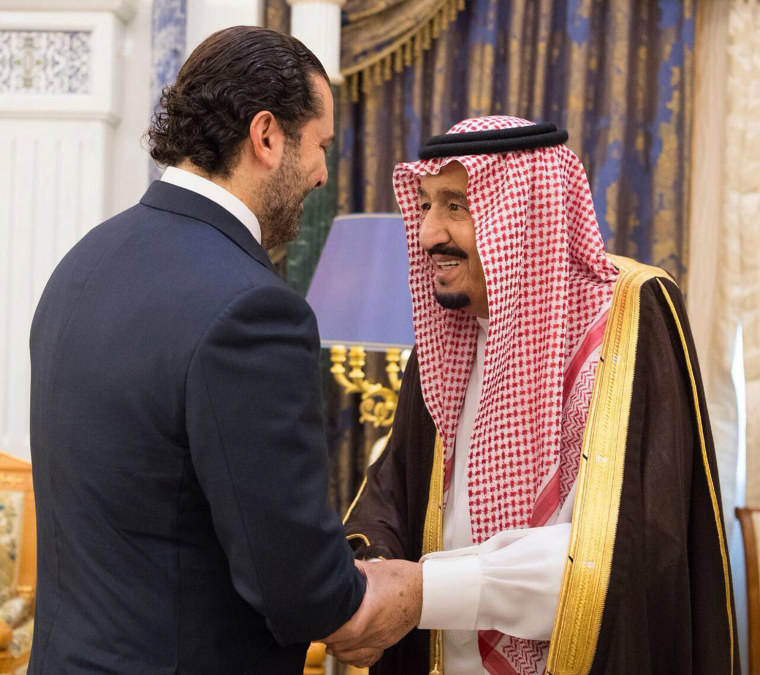 Image: Saudi King Salman, right, shakes hands with outgoing Lebanese Prime Minister Saad Hariri in Riyadh