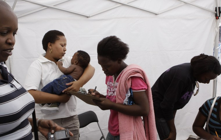 Image: A woman registers at a mobile health care clinic in Johannesburg
