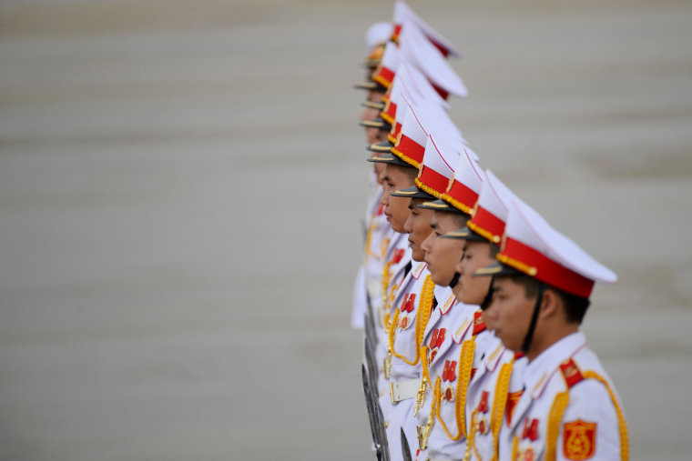 Image: Members of a Vietnamese honor guard stand at attention