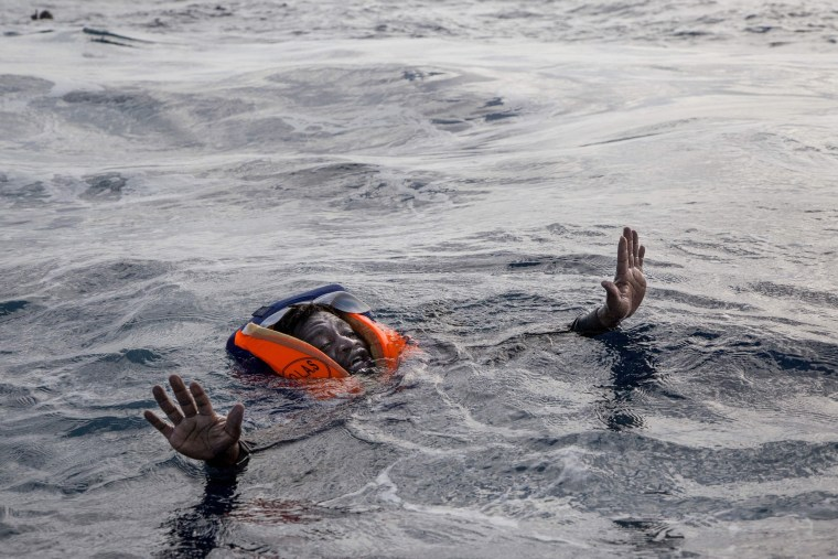Image: A migrant tries to board a boat