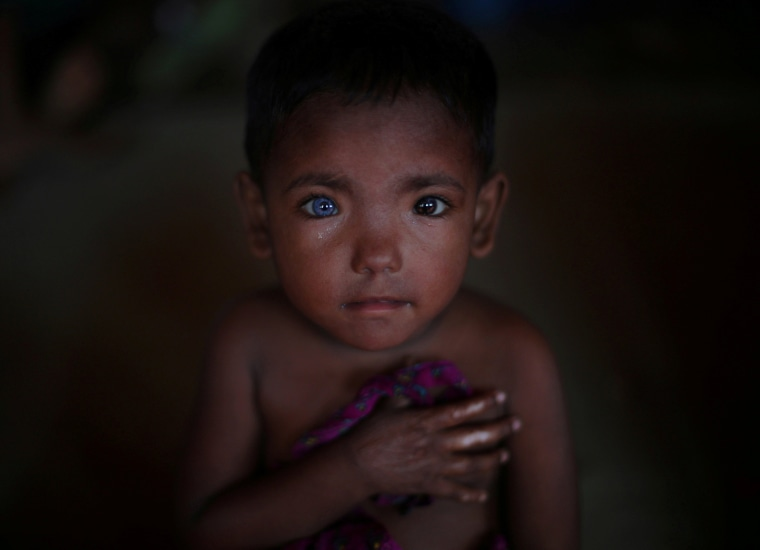 Image: Refugee child who fled Myanmar two-months ago listens to singing at Kutupalong refugee camp near Cox's Bazar