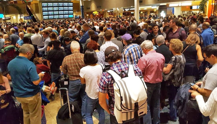 Image: The line to wait for security at Orlando International Airport after a camera battery exploded, on Nov. 10, 2017.