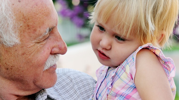Grandfather holds granddaughter