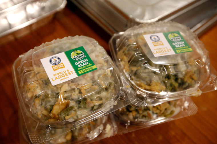 Individual servings from the Guinness World Records Largest Serving of Green Bean Casserole, made by Green Giant and weighing in at 637 pounds, are prepared for donation to Citymeals on Wheels, Thursday, Nov. 16, 2017 in New York. (Jason DeCrow/AP Images for Green Giant)