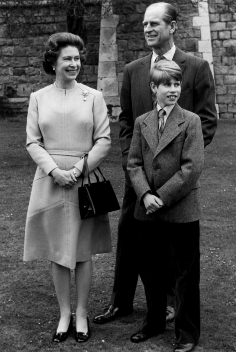 Queen Elizabeth II poses April 15, 1976, on the grounds of Windsor Castle with Prince Phillip and their youngest son, Prince Edward, 12, for a photo to commemorate the Queen's 50th birthday which falls on April 21. (AP Photo)