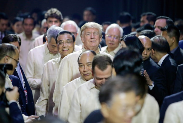 Image: Trump smiles in front of Chinese Premier Li Keqiang as they enter the Special Gala Celebration of the 50th Anniversary of ASEAN in Manila, on Nov. 12.