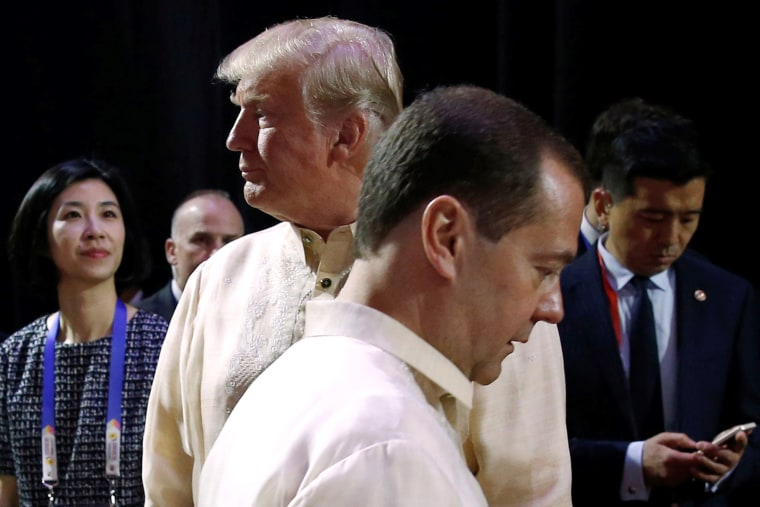 Image: Russia's Prime Minister Dmitry Medvedev crosses paths with Trump at the ASEAN Summit gala dinner in Manila, on Nov. 12.