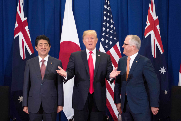 Image: Japan's Prime Minister Shinzo Abe, Trump and Australian Prime Minister Malcolm Turnbull attend a trilateral meeting during the opening ceremony of the ASEAN Summit on Nov. 13.