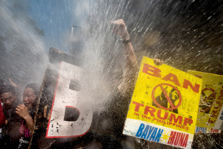 Image: Protesters are soaked as they clash with riot police while marching the streets of Manila during the start of the ASEAN meetings on Nov. 13.