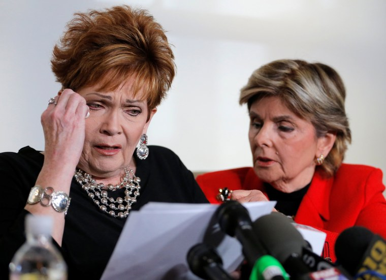 Image: Beverly Nelson wipes tears as she reads a statement to reporters with attorney Gloria Allred during a news conference announcing new allegations of sexual misconduct against Alabama Republican congressional candidate Roy Moore, in New York