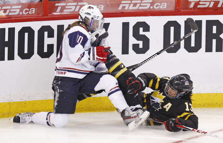 Image: Canada's Ouellette crashes into Chu of the US