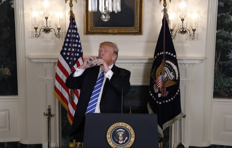 Image: President Trump takes a drink of water while speaking at the White House in Washington