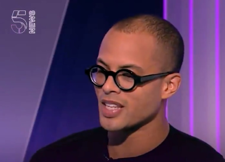 Image: Josh Rivers speaks during an interview with 5NEws