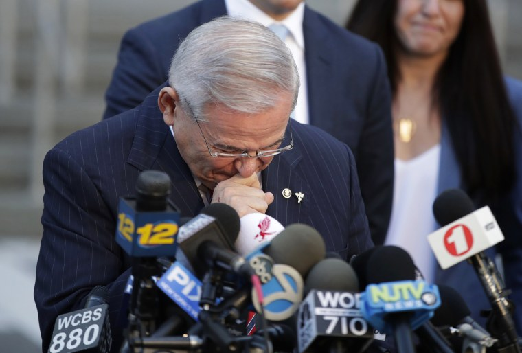 Image: Menendez fights tears as he speaks to reporters
