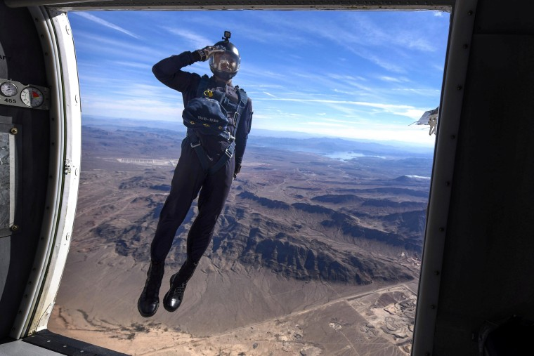 Image: A member of the Air Force's Wings of Blue Parachute Demonstration Team jumps out of an aircraft at Nellis Air Force Base