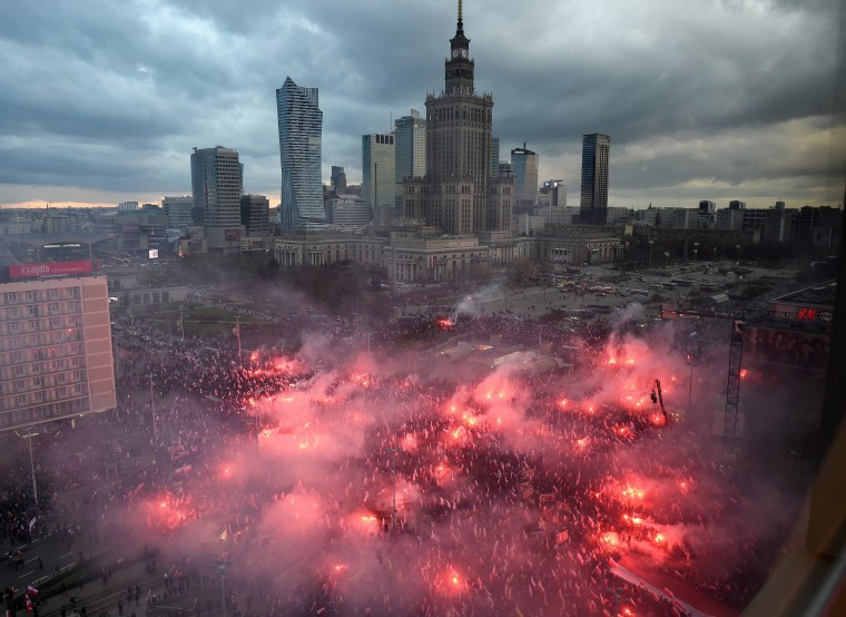 Image: Polish nationalists light flares as they take part in the March of Independence