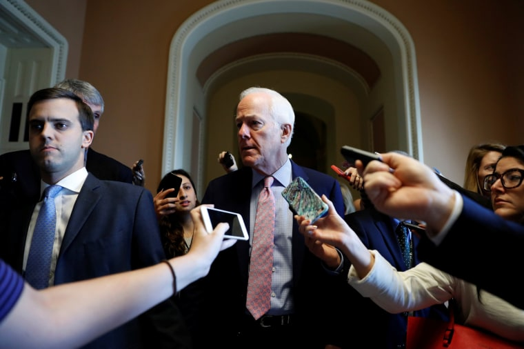 Image: Sen. John Cornyn (R-TX) speaks to reporters after a meeting about the Republican Tax Reform package on Capitol Hill in Washington