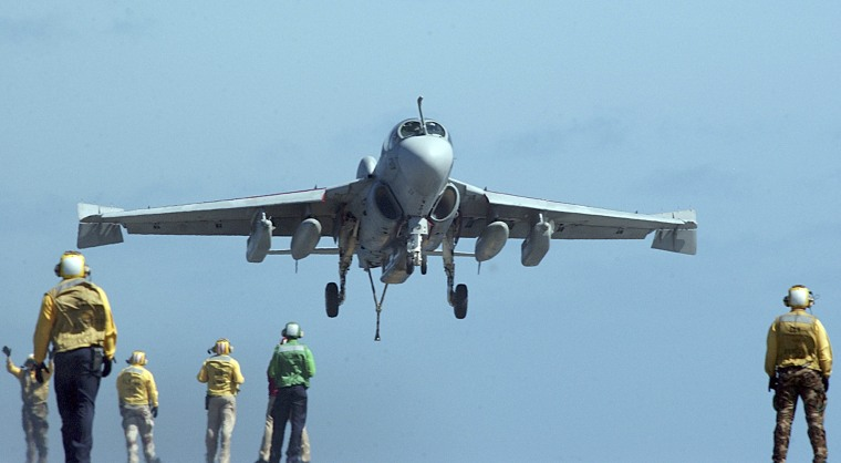 "Image: An EA-6B Prowler, assigned to the ""Eagles"" of Electronic Attack Squadron One Two Nine (VAQ-129), lands aboard the aircraft carrier USS Ronald Reagan in the Pacific Ocean, May 18, 2005."