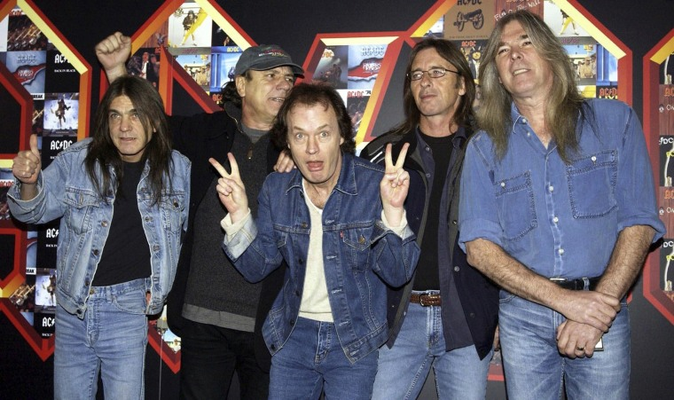Image: Malcolm Young, Brian Johnson, Angus Young, Phil Rudd and Cliff Williams from AC/DC posing for photographers at the Apollo Hammersmith in London, March 3, 2003.