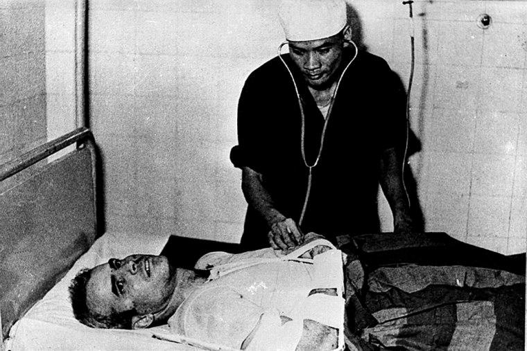 Image:  A Vietnamese doctor examines John McCain