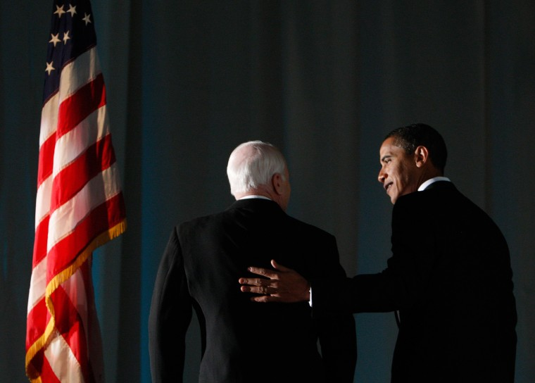 Image: U.S. President-elect Barack Obama speaks with U.S. Senator John McCain at a bipartisan dinner honoring McCain in Washington