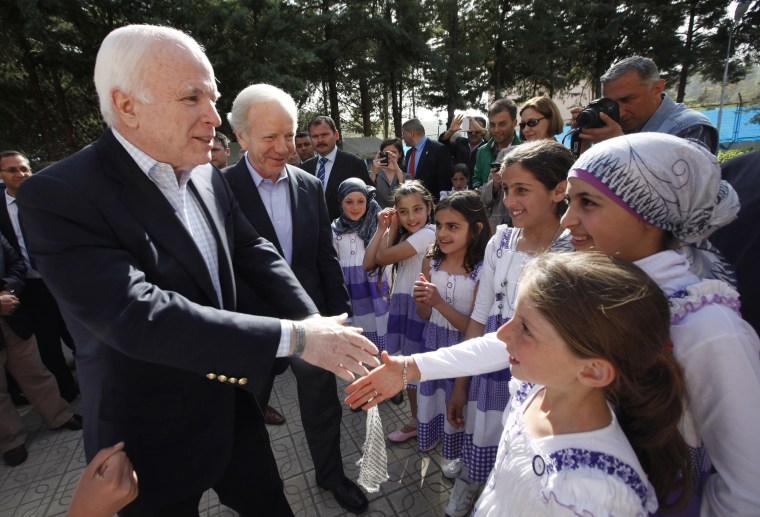Image: U.S. Senators McCain and Lieberman are greeted by Syrian refugee children during their visit at Yayladagi refugee camp in Hatay province on the Turkish-Syrian border
