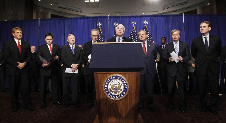 "Image: U.S. Senate's ""Gang on Eight"" are pictured during a news briefing on Capitol Hill in Washington"