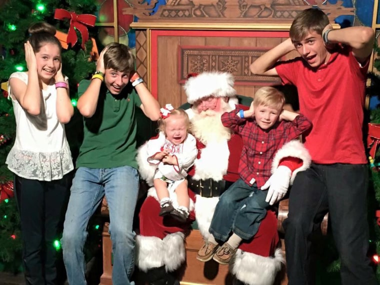Jenny Bassett says her older children were excited to take their baby sister, Bea, to see Santa. Bea, however, was having none of it.
