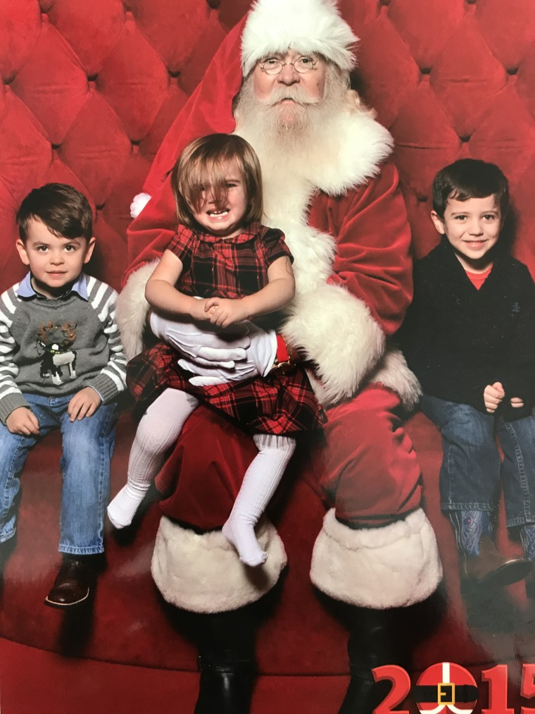 A misplaced hair bow and a crying toddler did not stop Emily Walker from getting a photo of her kids with Santa.