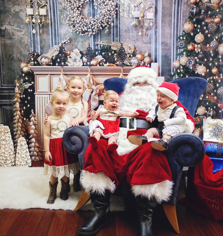 """Marianne Wallace says she's learned to be patient with her kids and go with the flow during Santa photo sessions. \""""Don't force the smiles because often the best photos are the candid ones,\"""" she said."""
