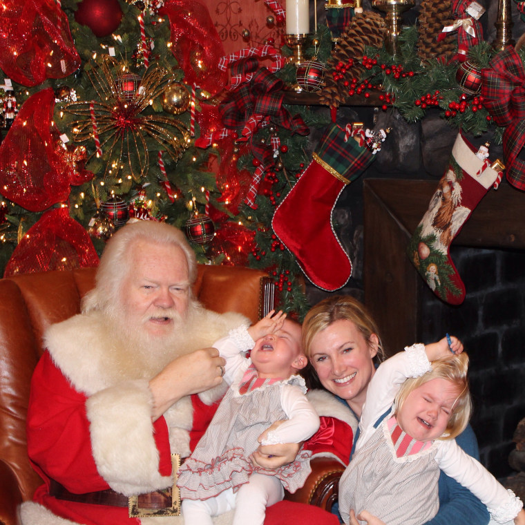 Kara Morey's daughters, Tabitha and Delilah, kicked and screamed, and tried to run away from Santa.