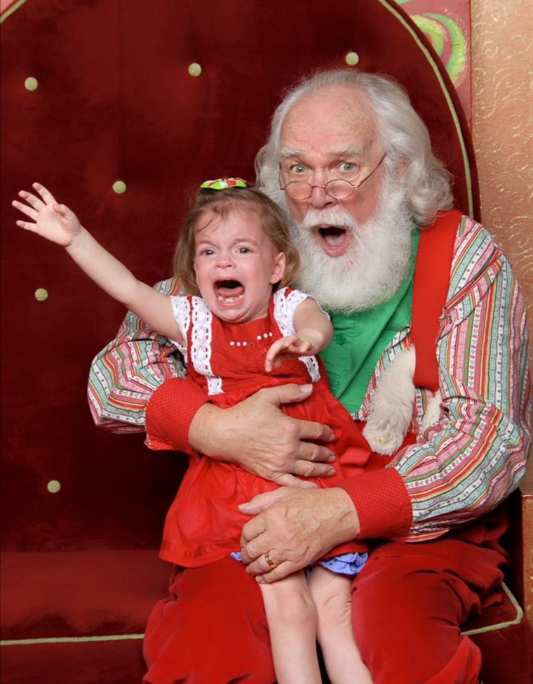 """Erica Jones says her daughter, Emmeline, has always been a \""""flight risk\"""" when it comes to photo with Santa."""