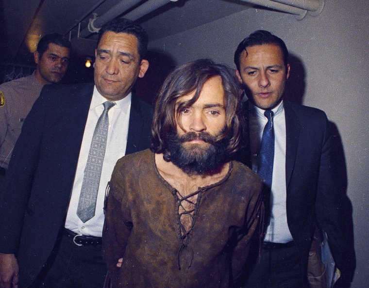 Image: Charles Manson is escorted to his arraignment on conspiracy-murder charges in connection with the Sharon Tate murder case in 1969 in Los Angeles, Calif.