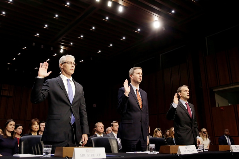 Image: Colin Stretch of Facebook, Sean Edgett of Twitter and Richard Salgado of Google are sworn in prior to testifying before Senate Intelligence Committee in Washington