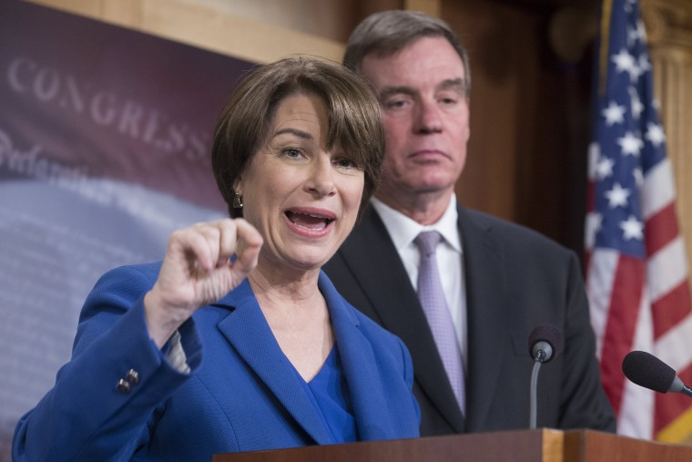 Image: Democratic Senator from Minnesota Amy Klobuchar and Democratic Senator from Virginia Mark Warner