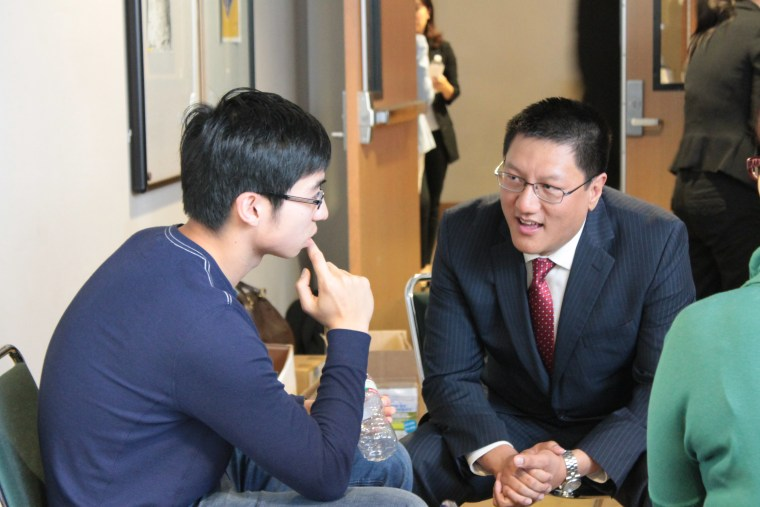 Steven Ma answers a high school student's question following one of his seminars.