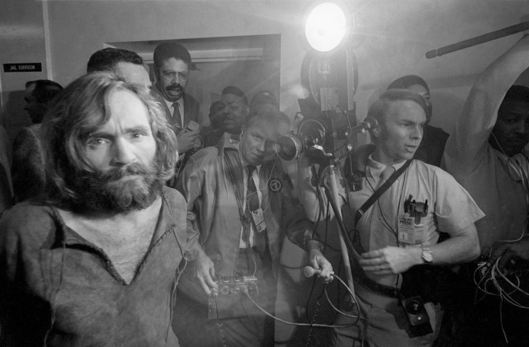 Image: Cameramen film Charles Manson as he is brought into the Los Angeles city jail under suspicion of having masterminded the murders of eight people over two nights.