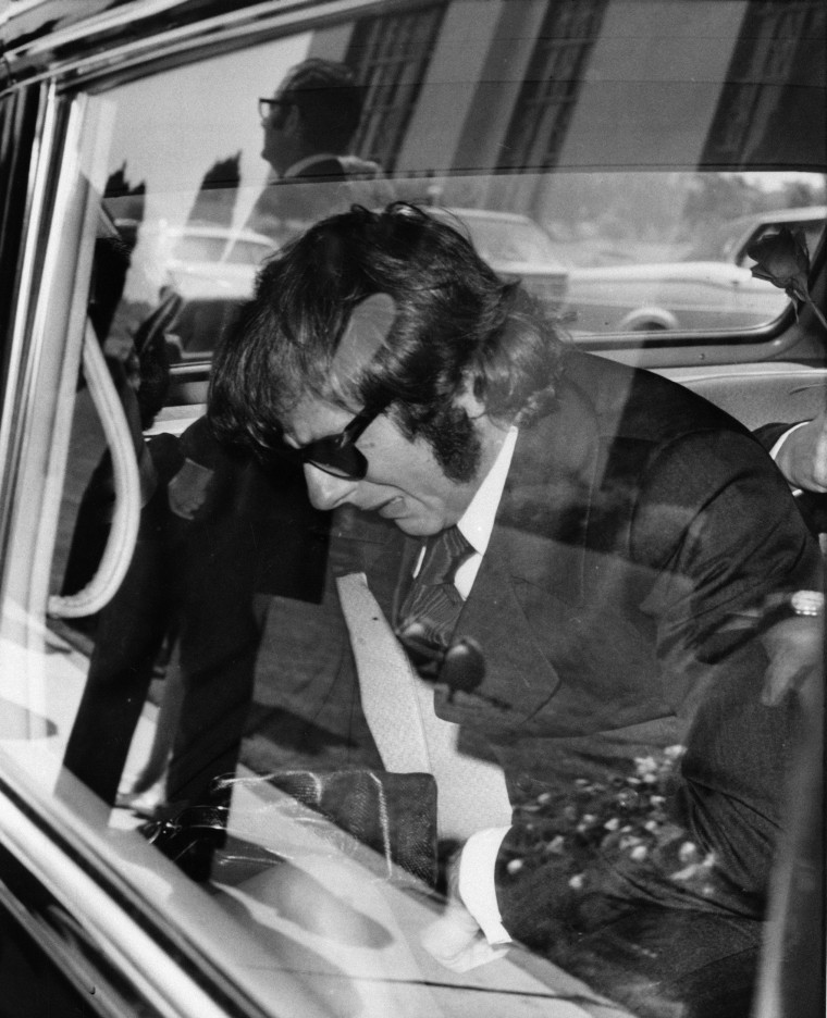 Image: Polanski breaks down inside the limousine after attending funeral services for his wife on Aug. 13, 1969.
