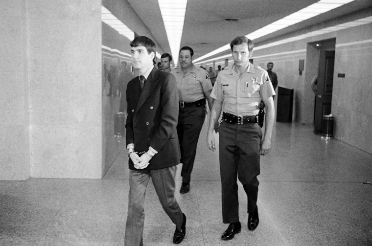 Image: Charles Tex Watson is led back to jail from the courtroom after he was convicted of seven counts of first degree murder and one of conspiracy to commit murder in the Tate-LaBianca slayings, on Oct. 12, 1971.