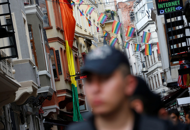 Image: Rainbow flags hang over a street as riot police prevent LGBT activists from gathering for a pride parade in Istanbul