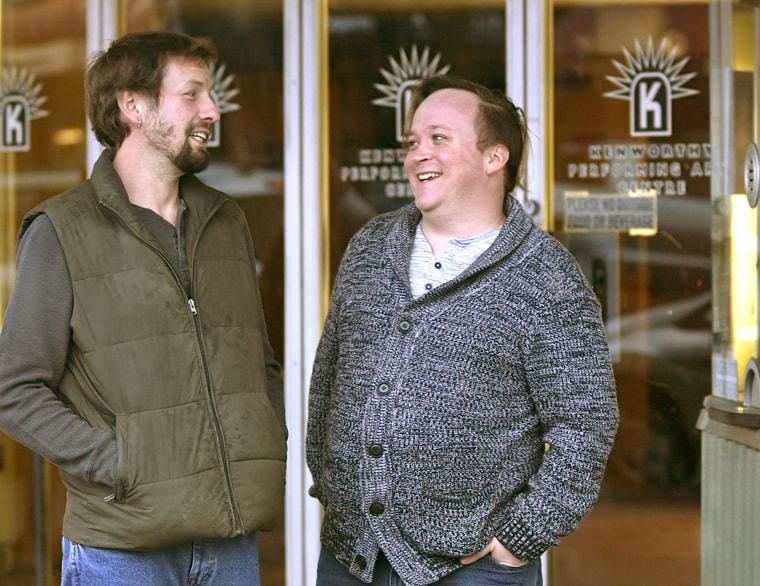 Image: Gordon Mellott, right, and husband Rob Rhodes in front of the Kenworthy Theater