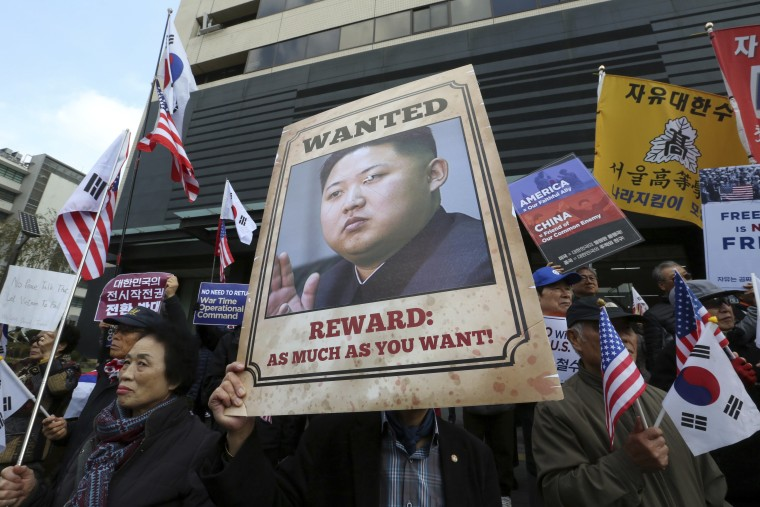 Image: Protester holds poster showing Kim Jong Un in Seoul on Nov. 6, 2017